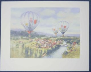 Hot Air Balloons over a Country Village. Carolyn ANDERSON